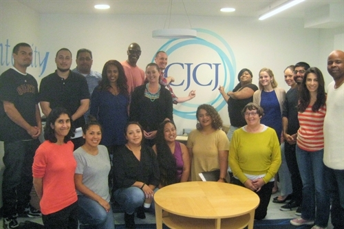 CJCJ staff members gather together in the new office space for the first time!