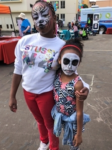 Cameo House children pose in character after having their faces painted.