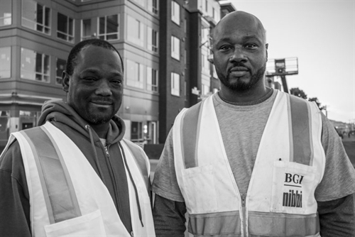 Yomo Shaw (left) and Maurice Scott (right) do construction work at Alice Griffith. They both served time in California state prison.