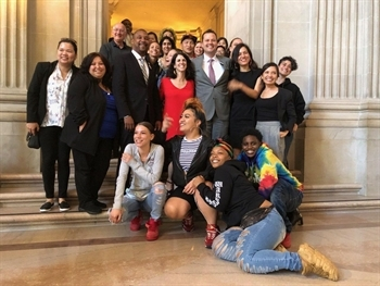 San Francisco youth and service providers pose with Supervisors Ronen, Walton and Haney in celebration of the decision to close the county's juvenile hall.