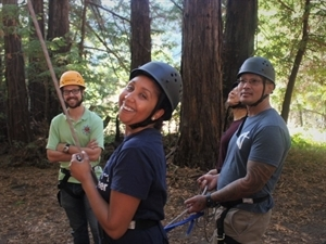 NGF Fellows, Terah Lawyer and Danny Thongsy, support their team member by holding tight to their rope.